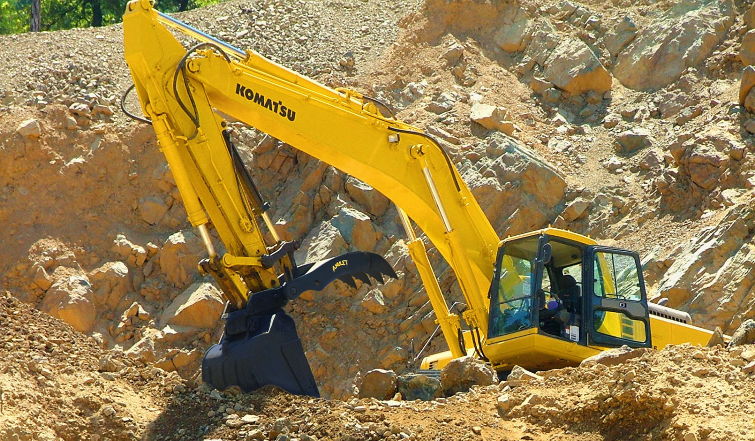 excavator with backhoe loader attachment